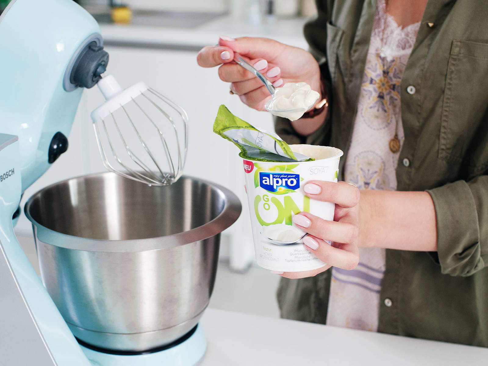 Meanwhile, prepare the cream. Mix together plant-based cream cheese alternative, agave syrup, remaining rosewater, and plant-based almond yogurt alternative until combined. Transfer cream to a piping bag fitted with a tip.