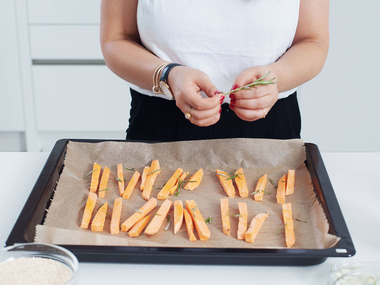 Preheat oven to 200°C/400°F. Peel sweet potato and cut into sticks. Chop rosemary. Transfer potatoes to a parchment-lined baking tray. Season with salt, top with rosemary, and drizzle with olive oil. Bake for approx. 30 min.
