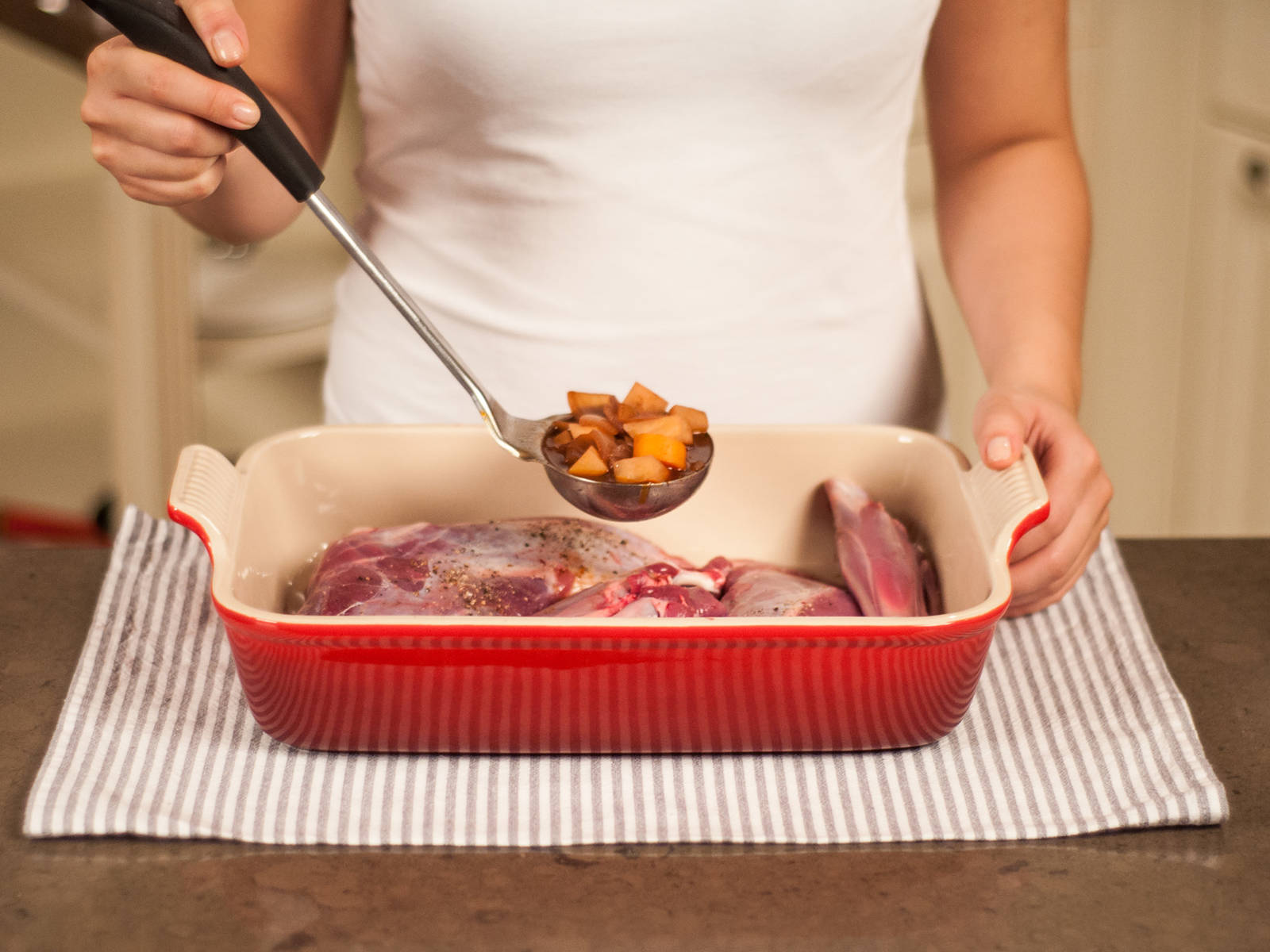 Place venison shoulder in a baking dish and ladle red wine and vegetable mixture on top. Add half of the venison stock and quince juice and bake in preheated oven at 170°C/350°F for approx. 50 min., removing from oven several times to add remaining venison stock and quince juice.