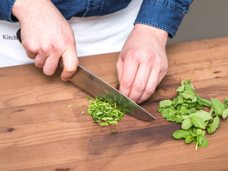 Wash the mint and cilantro, then remove the leaves and chop. Discard the stalks. Chill leaves in the refrigerator.