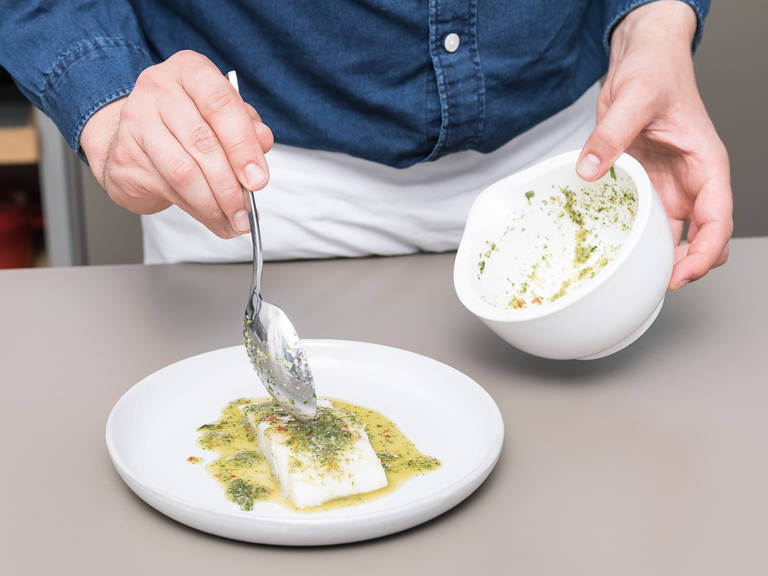 Lift the foil up to take the fish fillets out of the water. Serve the fish and pour the sauce over each fillet. Decorate with chopped scallions. Enjoy!