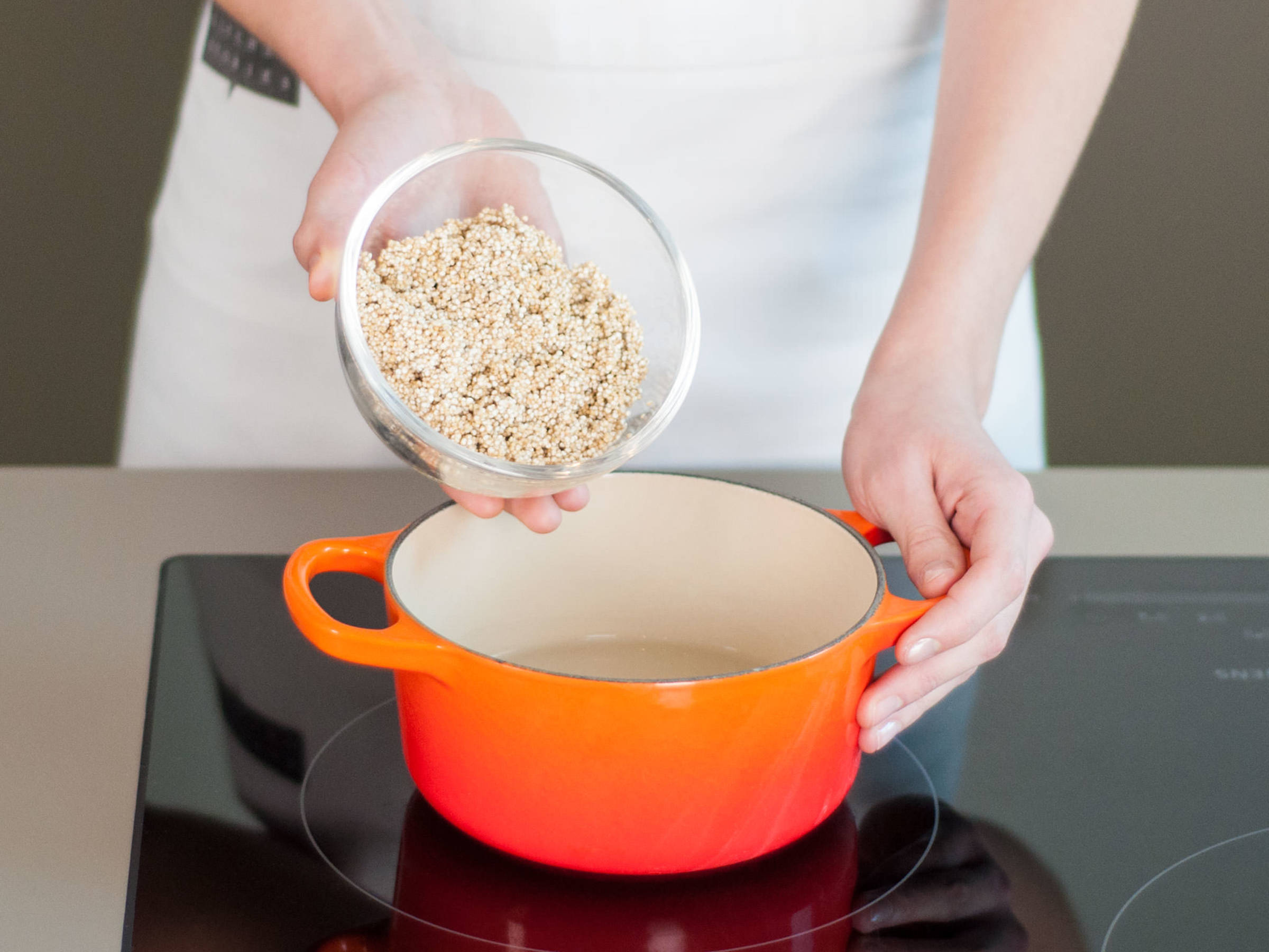 Rinse quinoa under water and add to saucepan with salted water. Bring to a boil. Then, cover and reduce heat to low. Cook for  approx. 15 min. until tender. Remove from heat and let stand, covered, for  approx. 5 min.
