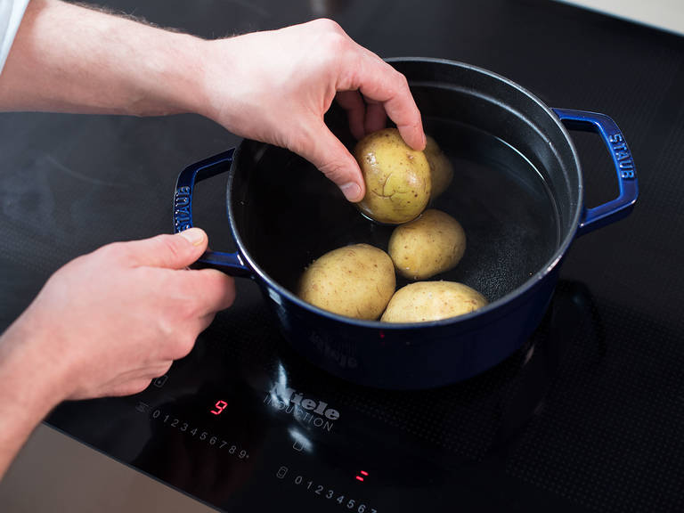 Bring a pot of water to a boil. Add potatoes and cook for approx. 20 min., or until knife-tender.