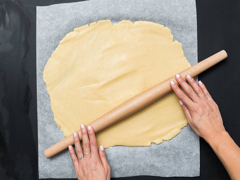 Take the doughs out of the fridge and roll each out separately on parchment paper to approx. 1 cm/ 0.5 in. thick. Place the black dough on top of the white dough and lightly press to seal. Carefully roll into a log to create a spiral. Wrap and transfer to the freezer for approx. 20 – 30 min.