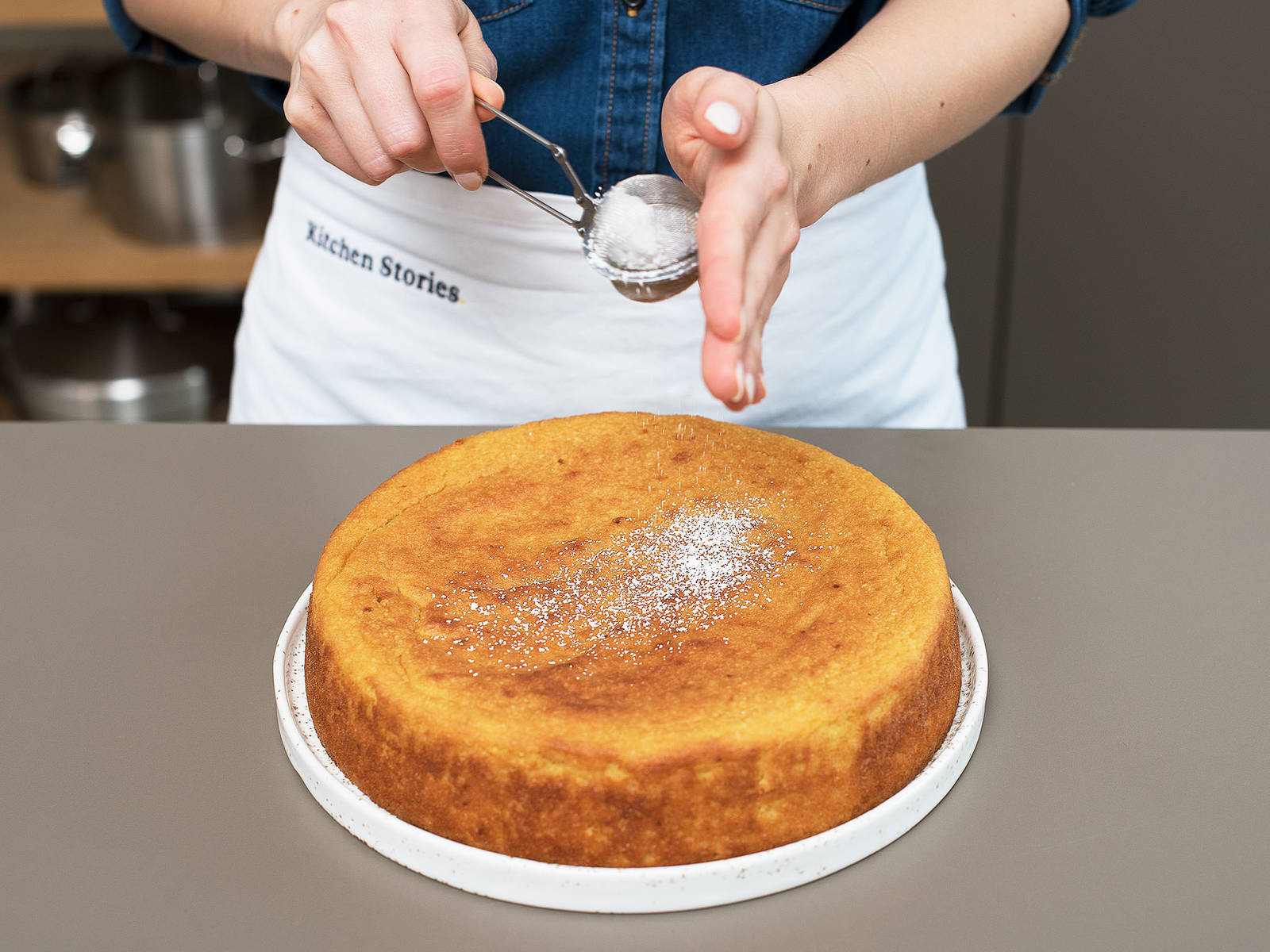 Remove cake from oven and place on a wire rack to cool before turning cake out of pan. Dust with confectioner's sugar before serving and enjoy!