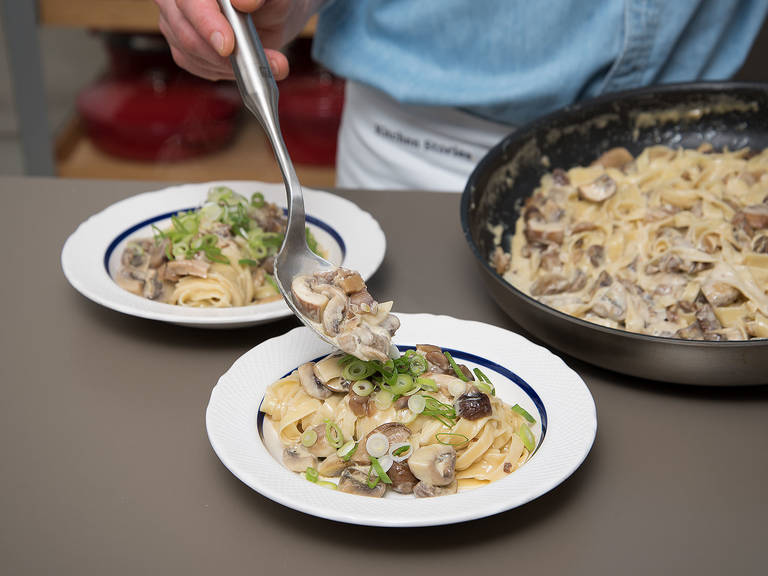 Drain pasta, transfer to frying pan, and stir to combine. Serve pasta and garnish with spring onions. Enjoy!
