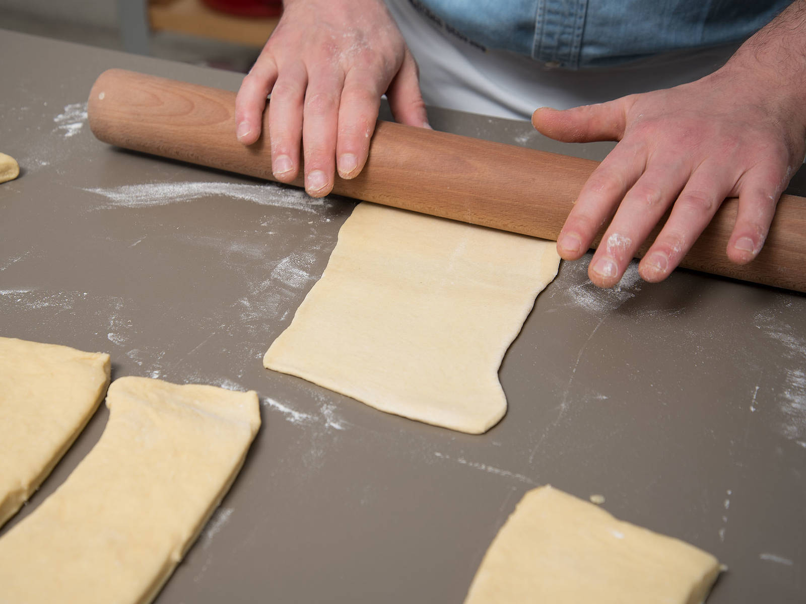 Preheat the oven to 200°C/400°F. Transfer dough to a floured work surface. Knead again briefly, then divide dough into equal parts. Roll out each piece of dough until 20x10 cm/8x4-in. size.
