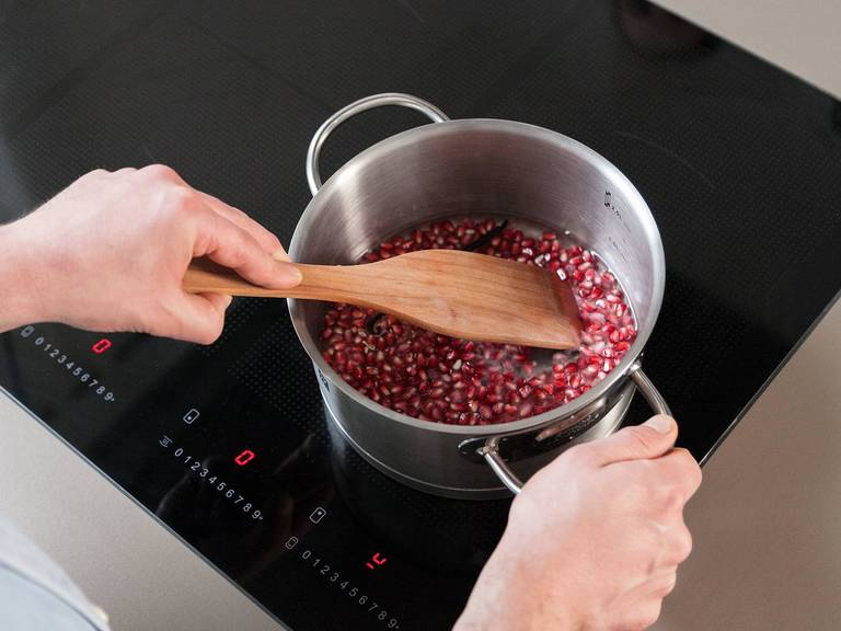 Add pomegranate seeds, sugar, water, vanilla bean and seeds to a pot and bring to a boil. Reduce heat to low and let simmer for approx. 20 min., stirring occasionally.