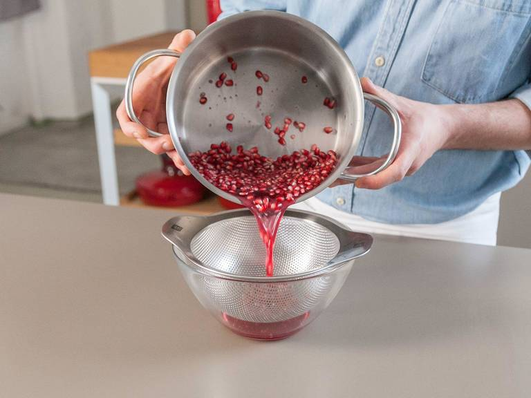 Strain grenadine syrup through a sieve. With a rubber spatula, press out juice from pomegranate seeds. Let cool, then transfer to a bottle.