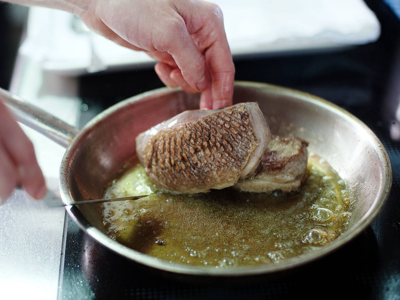 Heat oil in a frying pan set over medium-high heat. Sear duck breast. Spoon hot oil over the skin, then flip duck breast. Remove from frying pan and let oil drain from meat.