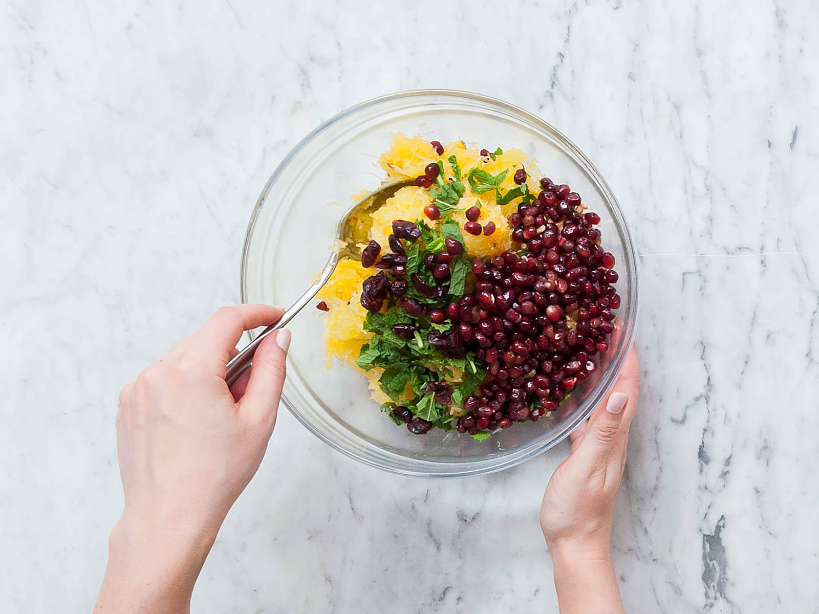 Remove squash from oven, fray out the pulp with a fork, add to a large bowl and let cool down. Once cool, add mint, walnuts, dried cranberries, and pomegranate seeds and mix well.