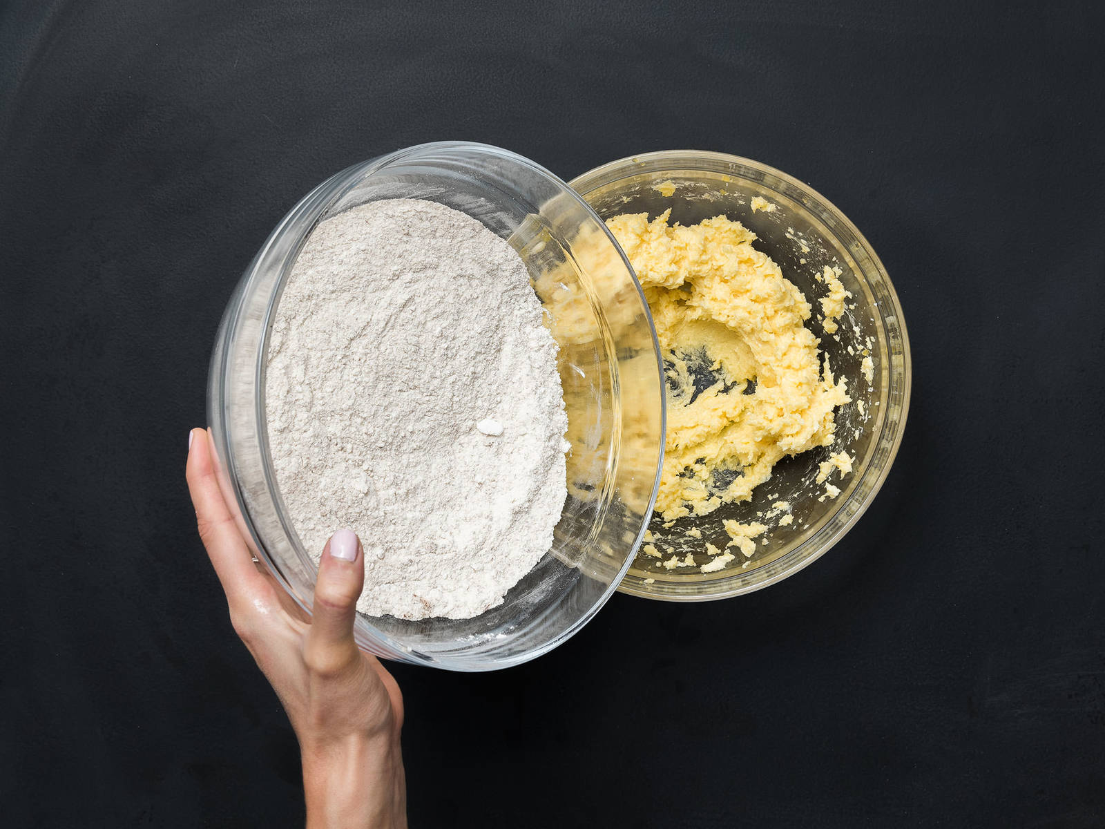 Preheat oven to 180°C/350°F. Beat together soft butter, sugar, vanilla sugar, salt, egg yolks, and vanilla extract in a bowl. In another bowl, mix together flour, starch, and ground almonds and add alternately to the butter-egg mixture, until a smooth dough forms.