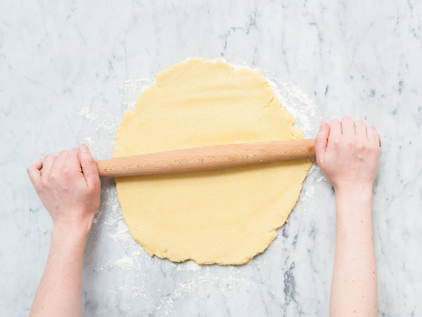 Add flour, sugar, baking powder, salt, butter, and eggs to a large mixing bowl and mix with a hand mixer until combined. Transfer dough onto a floured work surface and roll out until it's approx. 1-cm/0.5-inch thick. Cut into rectangles using a knife or pastry wheel,