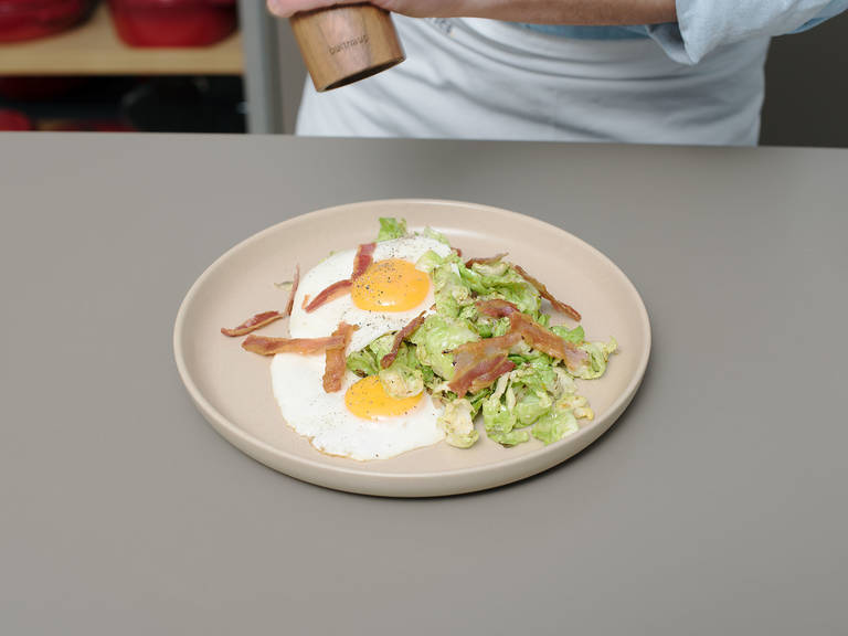 Spread Brussels sprouts on plates, and serve with bacon and fried eggs. Season with salt and pepper. Enjoy!