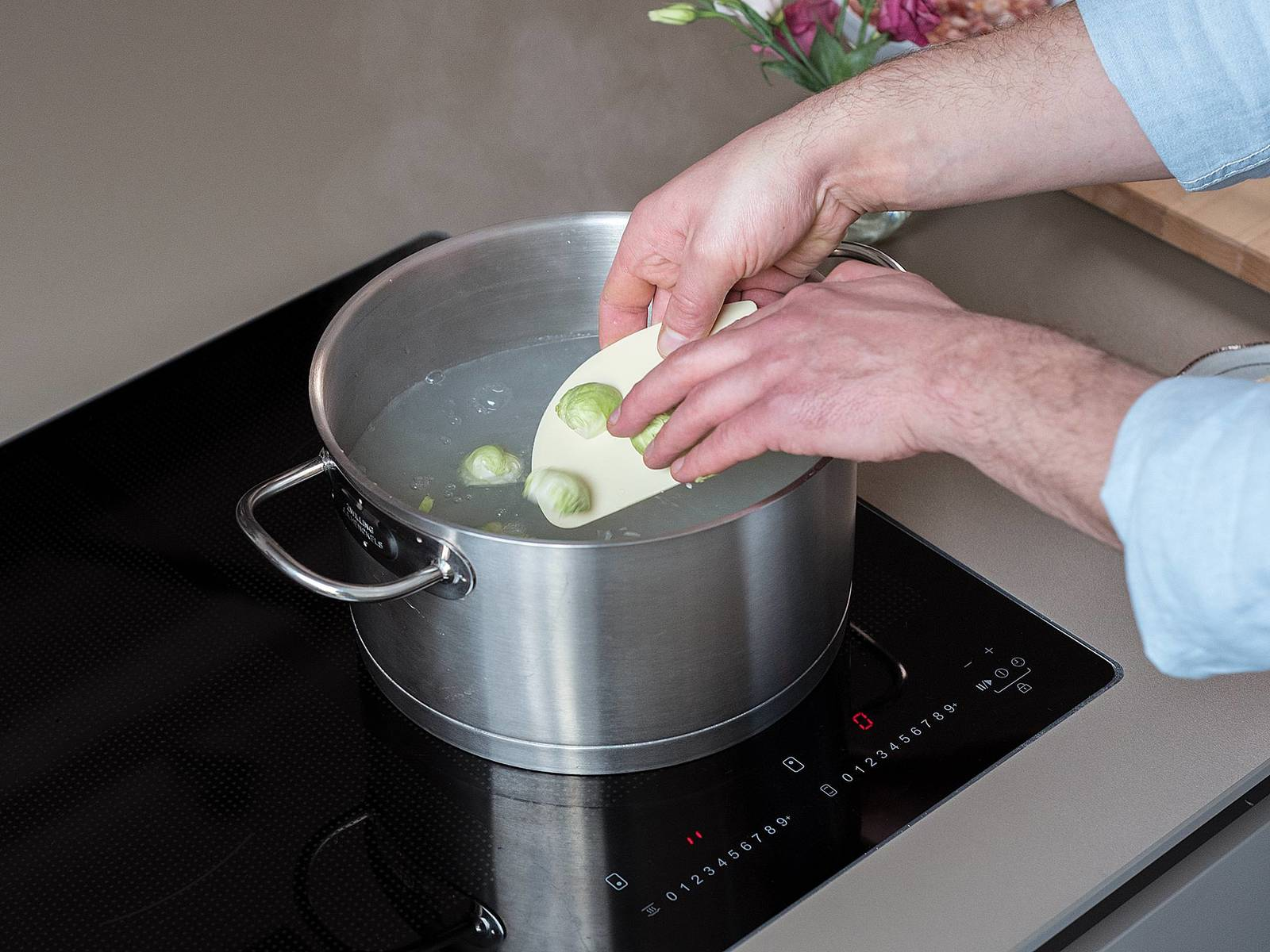 Drain pasta and transfer cooking water back into pot. Add Brussels sprouts and blanch for 3 – 5 min.