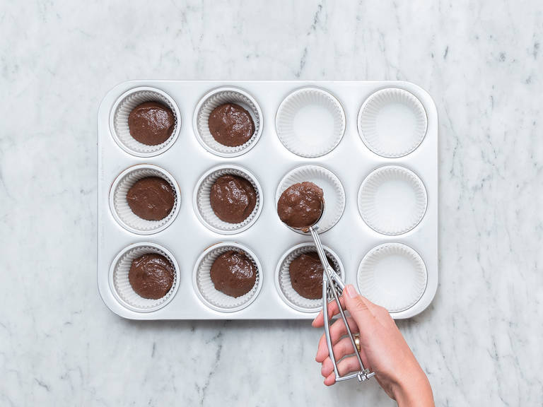 Use an ice cream scoop to add an equal amount of dough to each muffin liner. Bake with convection heat at 180°C/3560F for approx. 20 min. Let cool completely, then dust with cocoa powder before serving. Enjoy!