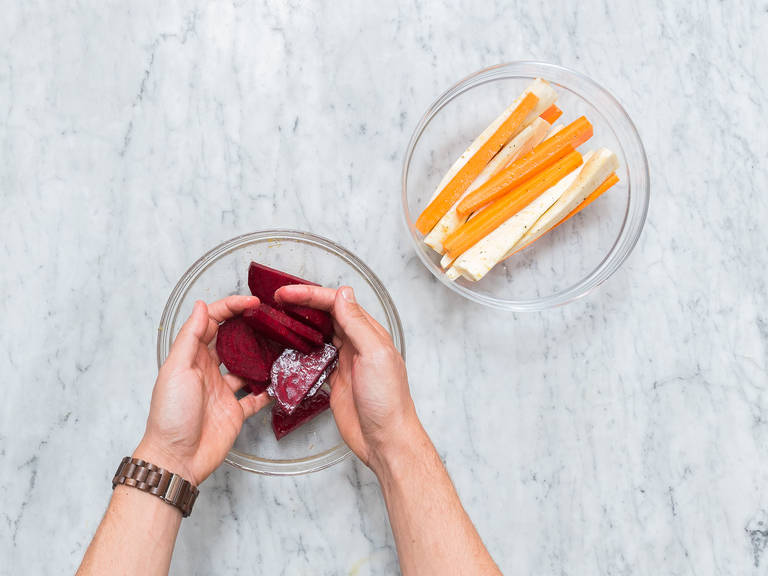 Pre-heat oven to 200°C/390°F. Peel carrots and parsnips and quarter them lengthwise. Peel and halve beetroot, then cut into 1-cm/0.4-in. slices. In a bowl, combine the vegetables with lemon zest and olive oil. Season with salt and pepper.