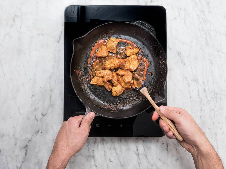 Heat oil in a pan over medium-high heat and sauté the marinated chicken for approx. 3 – 4 min. until cooked through. Remove chicken from pan.