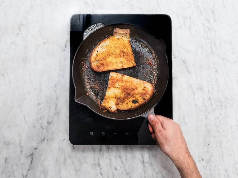 In the same pan, melt butter over medium heat. Season slices of bread with salt and sugar on both sites and fry on each side for approx. 2 – 3 min., until crispy.