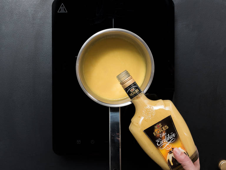Finely chop white chocolate. In a pot, heat eggnog over medium heat while stirring generously, making sure it doesn't burn. Remove from heat, add chopped chocolate and let rest for approx. 5 min., then stir until chocolate has dissolved. Refrigerate for overnight or at least 2 hrs., until thickened.