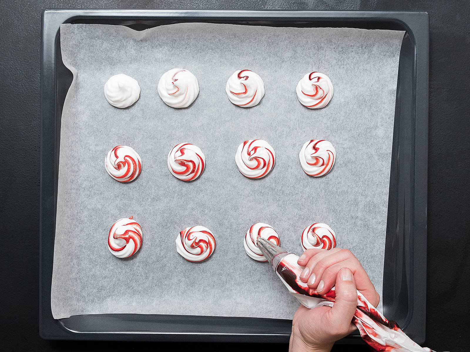 Pipe the meringue onto a parchment-lined baking sheet in circles approx. 4 cm/1.5 in. in diameter and 2.5 cm/1 in. high. Reduce heat to 120°C/250°F and bake for approx. 2 hrs., or until the meringues are firm. Crack the oven door open with a wooden spoon and let cool and dry slowly.
