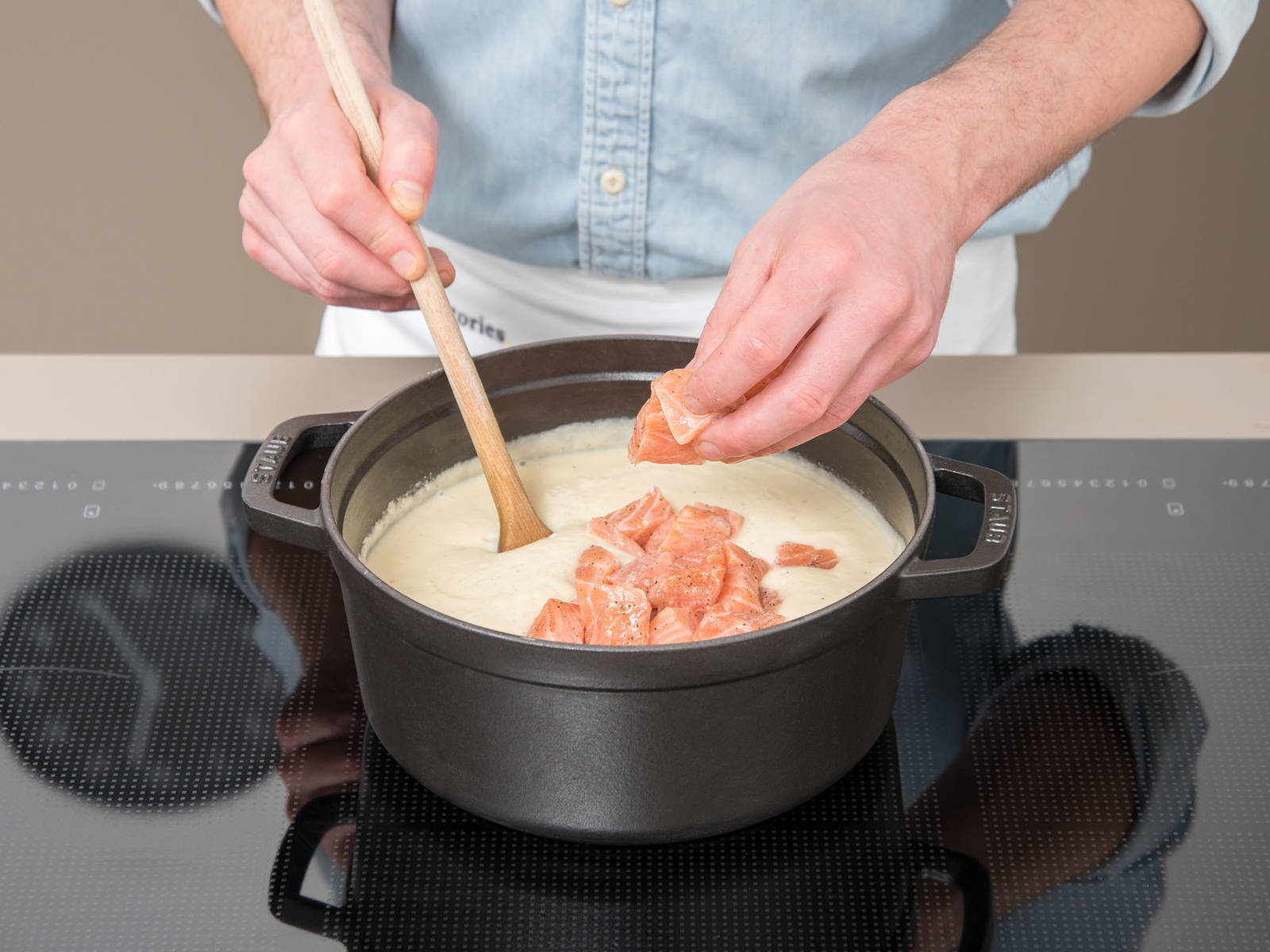 Add salmon fillet to the soup and slightly heat until salmon is cooked through. Serve soup with a slice of bread and garnish with chives, more horseradish, and pumpkin seed oil.