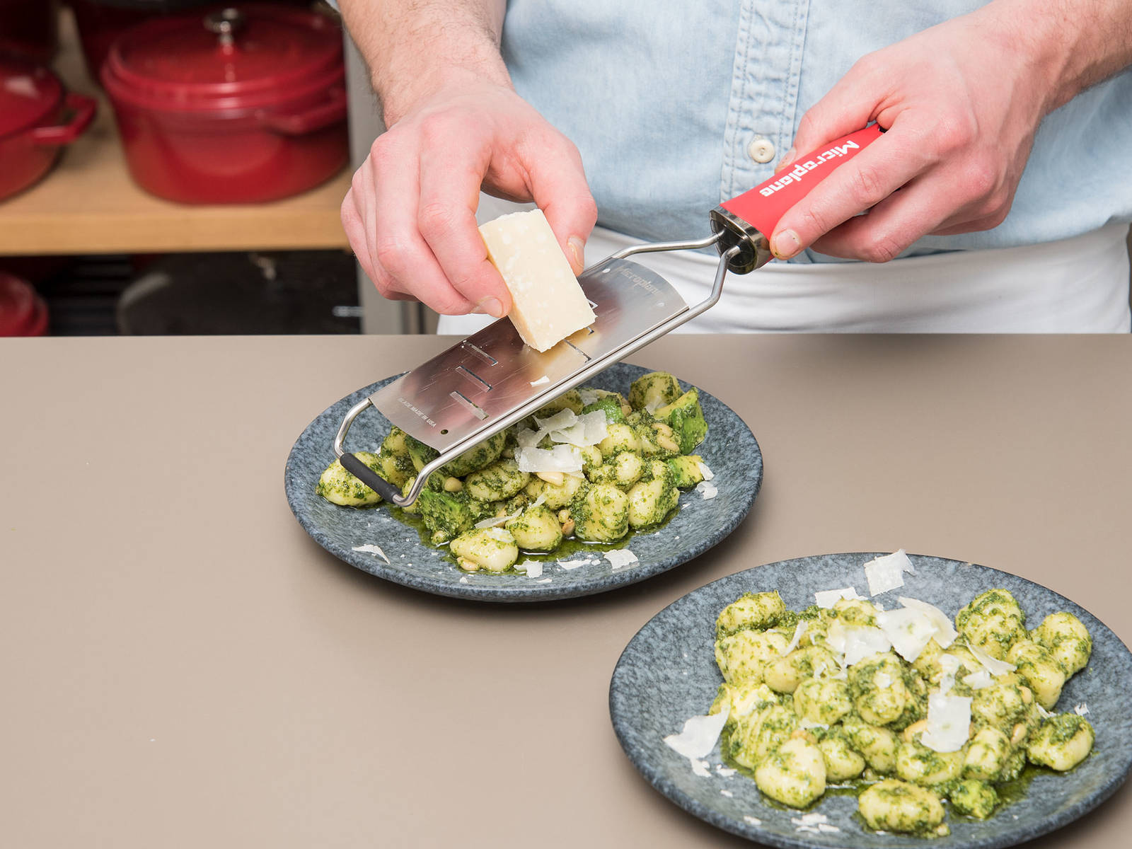 Serve gnocchi with freshly grated parmesan. Season with salt and pepper to taste and enjoy!