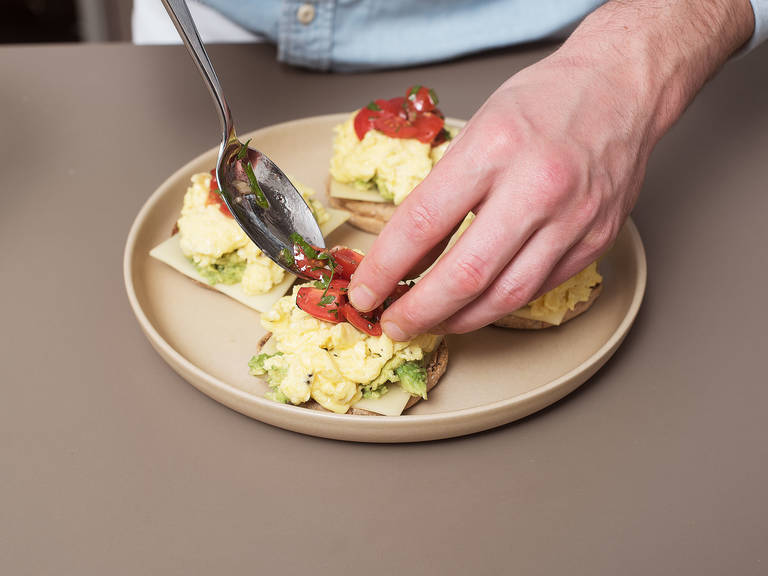 Top each halved English muffin with a slice of Alpine cheese, some avocado, scrambled eggs and salsa. Enjoy!