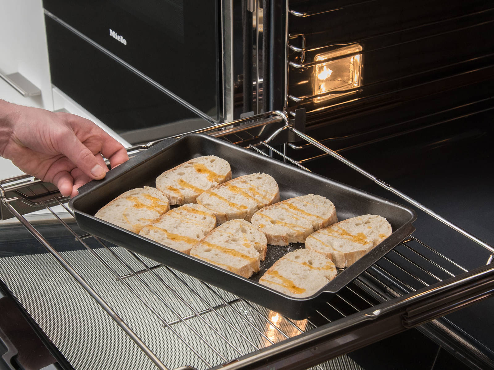 Pre-heat oven to 210°C/410°F. Slice bread and transfer onto a baking sheet. Toast in the oven for approx. 8 – 10 min.