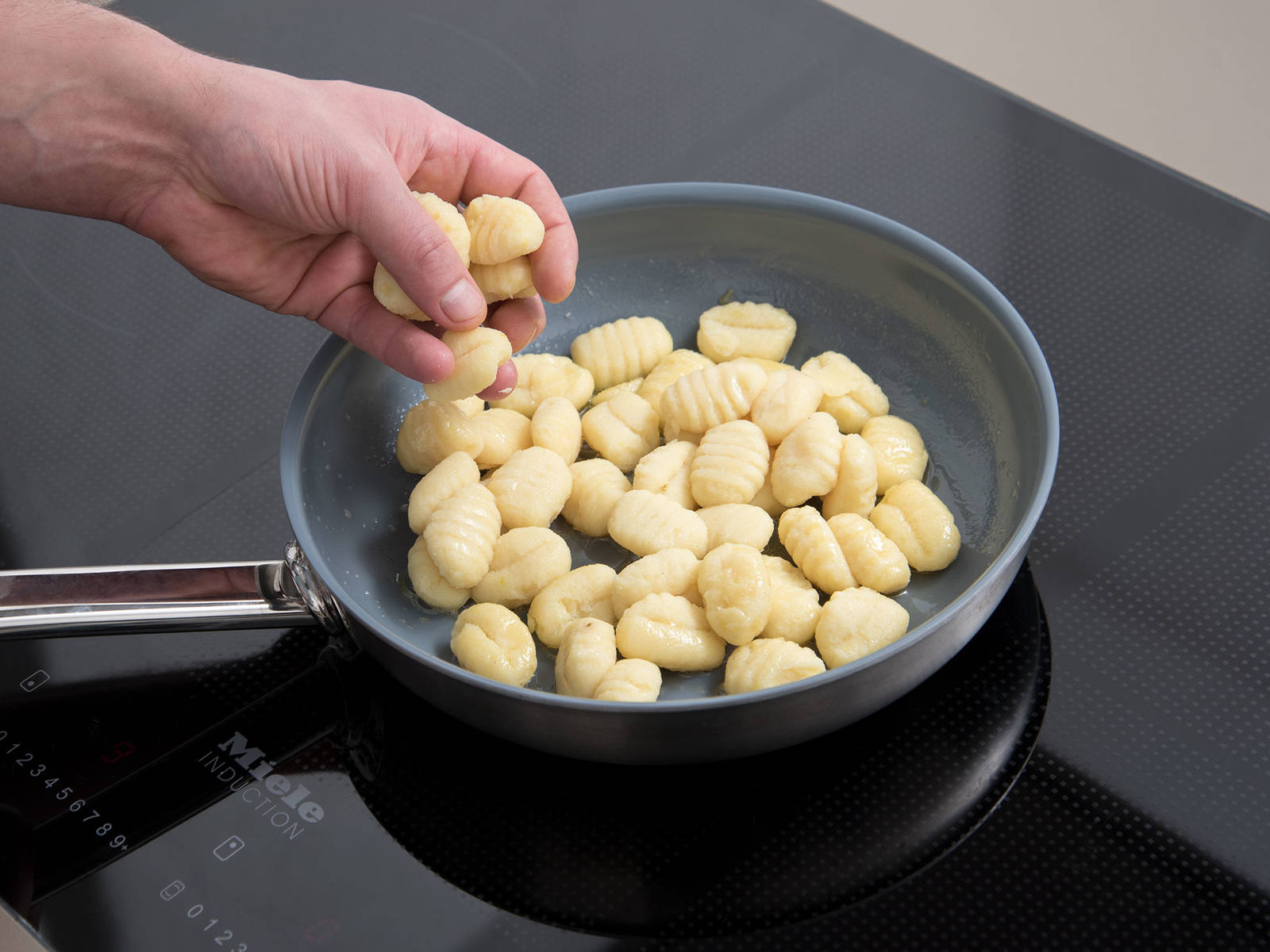 Meanwhile, melt butter in a frying pan. Fry gnocchi until lightly golden.