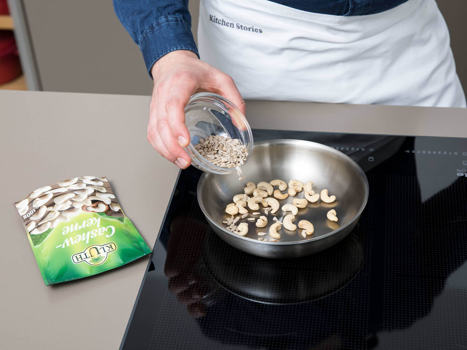 Heat a frying pan over medium-low heat. Toast cashews and sunflower seeds until fragrant and lightly browned, tossing often to avoid burning.