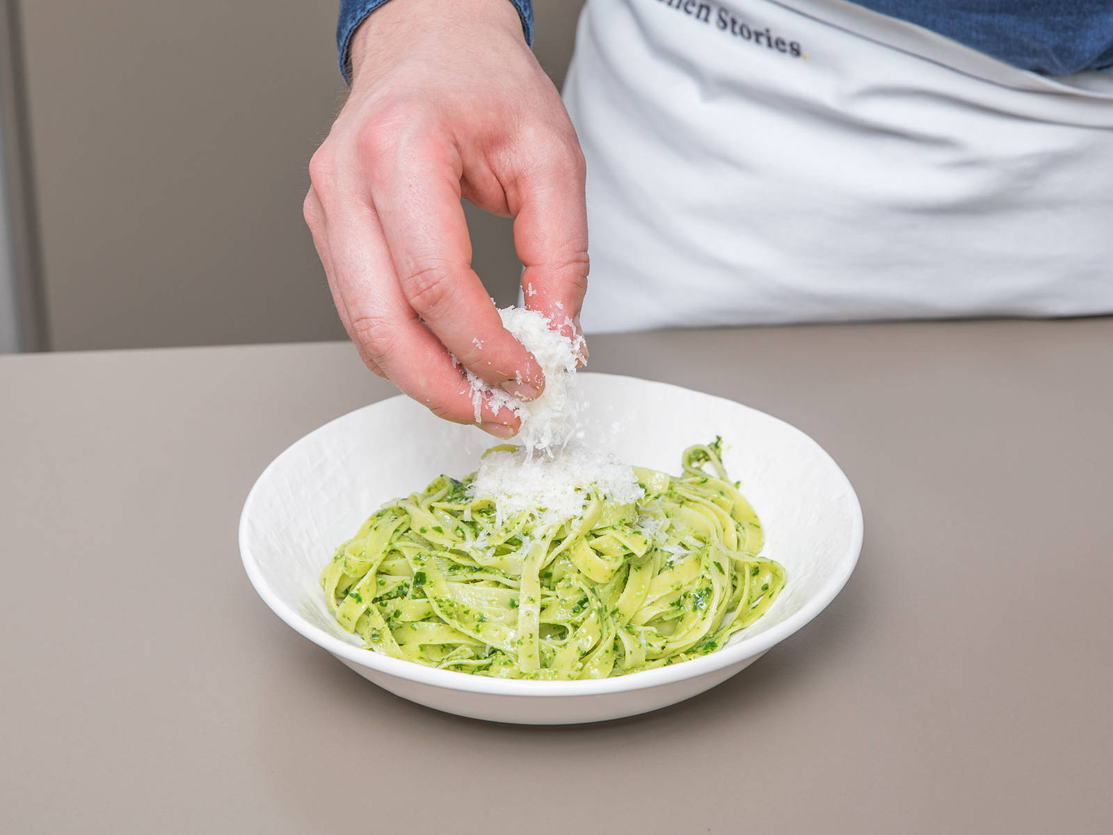Combine drained tagliatelle with wild garlic pesto. Serve with freshly grated Parmesan cheese and more wild garlic leaves. Enjoy!