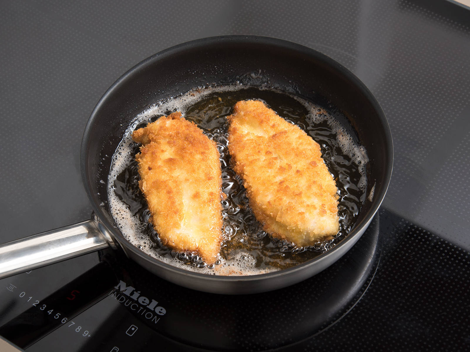 Add oil to a pan set over medium heat and fry chicken on each side for approx. 3 min., until brown and crispy. Serve chicken katsu with Chinese cabbage salad and rice and drizzled with mayonnaise sauce. Enjoy!