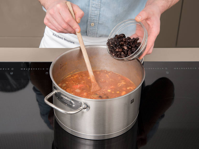 Add crushed tomatoes, vegetable stock, and quinoa to the pot. Season with soy sauce, cane sugar, salt and pepper. Bring to a boil and let cook, covered, for approx. 15 – 20 min. During the last 5 min., add black beans, kidney beans, corn, and walnuts to the pot.