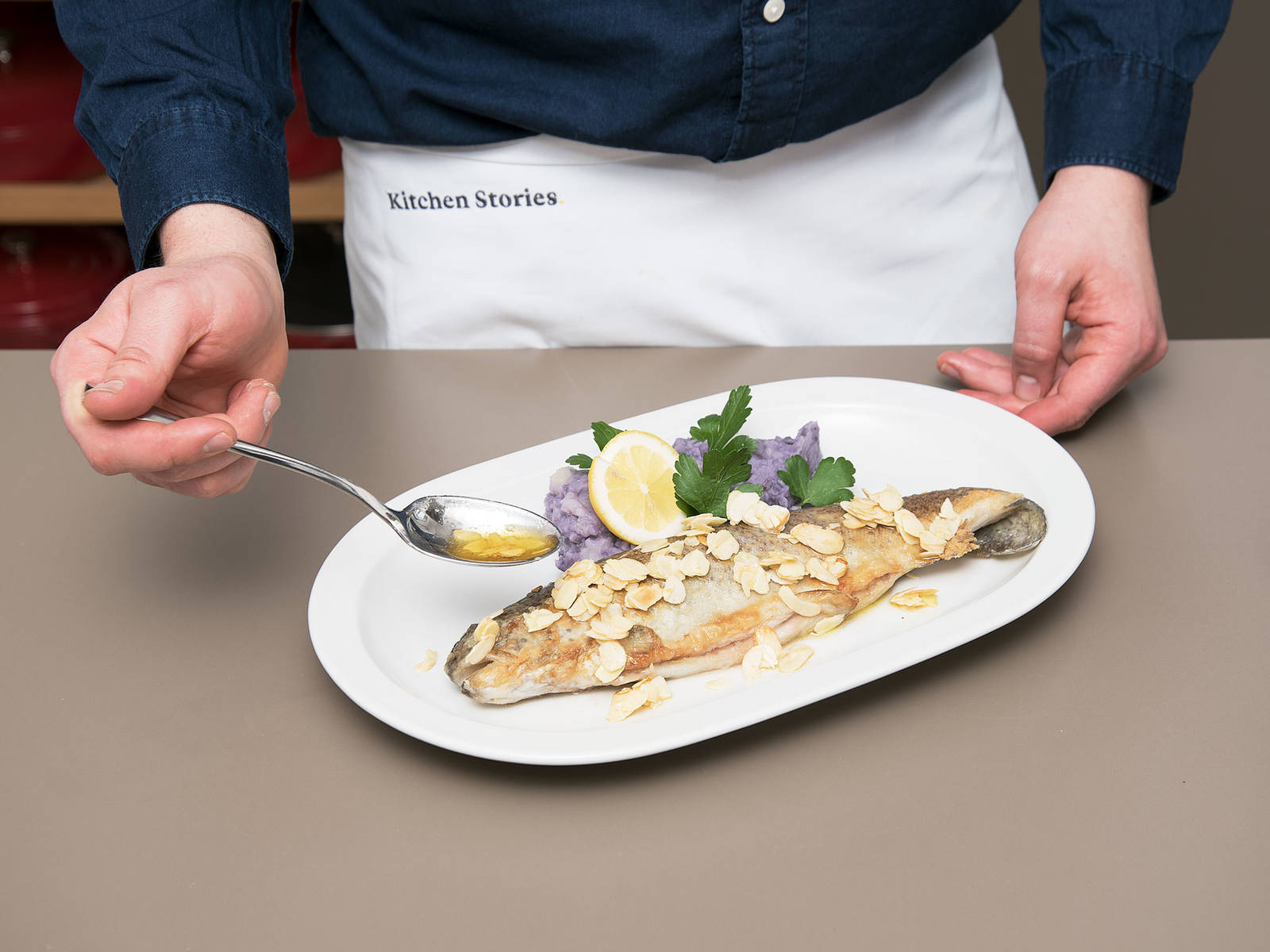 Serve trout on a plate and drizzle with almond butter. Serve with potato purée and a lemon wedge and enjoy!