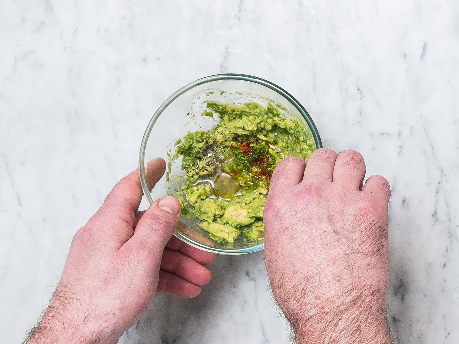 Halve and peel avocado, remove the pit, transfer to a small bowl, and mash with a fork. Season with remaining lime juice and zest, remaining cayenne pepper, salt, and olive oil to taste.