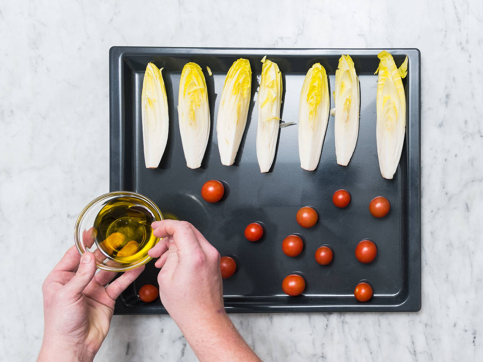 Pre-heat oven to 180°C/350°F. Wash endive and quarter. Transfer endive and tomatoes onto a baking sheet, drizzle with some olive oil, and season with salt, pepper, and sugar to taste. Roast in oven for approx. 8 – 10 min.