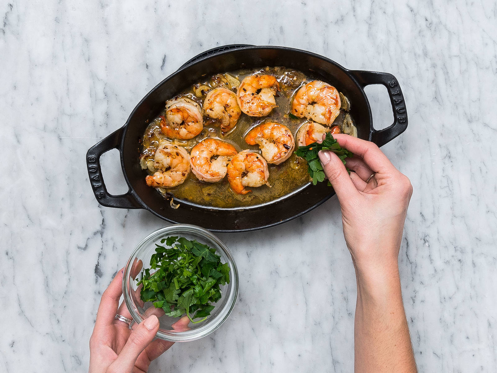 Add white wine to pan with shrimp and cook for approx. 1 – 2 min. more over medium heat. Remove from heat and sprinkle with chopped parsley and salt. Served with toasted baguette slices. Enjoy!