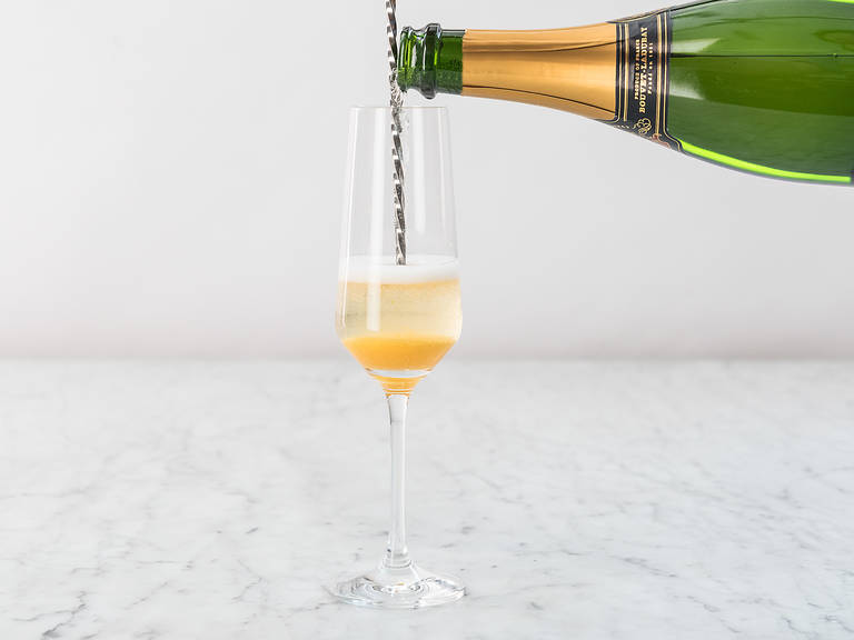 Add a few spoonfuls of the peach purée to each Champagne flute. Top with chilled Champagne and enjoy!
