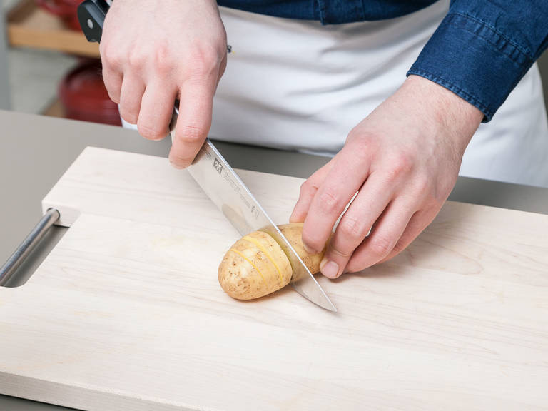 Preheat oven with convection to 180°C/360°F. Wash and dry potatoes. With a sharp knife, make thin cuts along the potatoes. Make sure not to cut all the way through the potatoes, so the bottom remains intact.