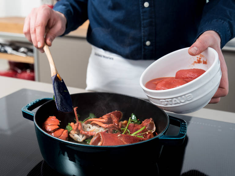 In a fresh pot or cocotte, heat half the olive oil over medium-high heat. Add the carrot, shallots, and garlic. Sauté for approx. 1 min. Stir in the lobster shells, thyme, bay leaf, parsley, and tomato paste. Add the tomatoes and wine and season with Piment d'Espelette, salt, and pepper. Cover and cook for approx. 20 min. over medium heat. Stir in the sour cream and reserved roe, should you have had a female lobster. Reserve and rinse lobster head and tail for plating. Salt to taste.