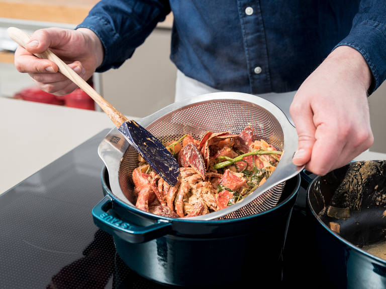 Remove the lobster-vegetable mixture from the heat and strain through a sieve into a clean pot. Remove as much liquid as possible and discard solids. Set pot over low heat and reduce into a thick sauce, whisking occasionally.