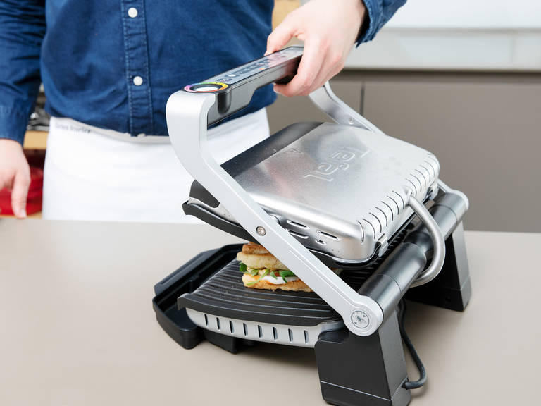 Grill in a hot panini press for approx. 5 min. or until the cheese is slightly melted, and the sandwich is crusty and hot. Cut in halves or quarters and enjoy!