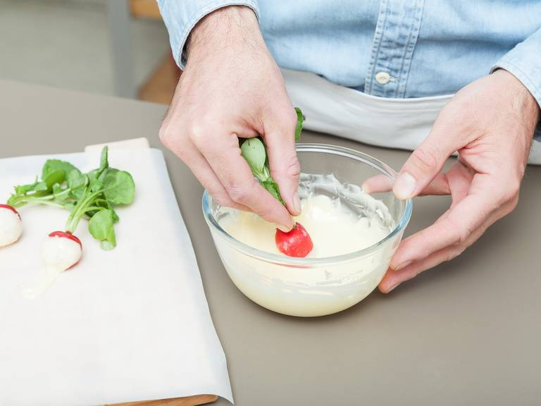 Dip the radishes halfway in the butter once, then again, and gently shake off any excess. Sprinkle some flaky sea salt over the butter dipped radish and set on a parchment lined plate. Refrigerate until butter is set, approx. 10 min. Serve immediately and enjoy!