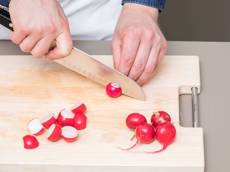 Preheat oven to 200°C/390°F. Wash and chop parsley, set aside. Wash, dry and halve radishes, then add to a baking dish. Add olive oil, Fleur de Sel and pepper and toss to coat. Pluck rosemary leaves and add to the baking dish.
