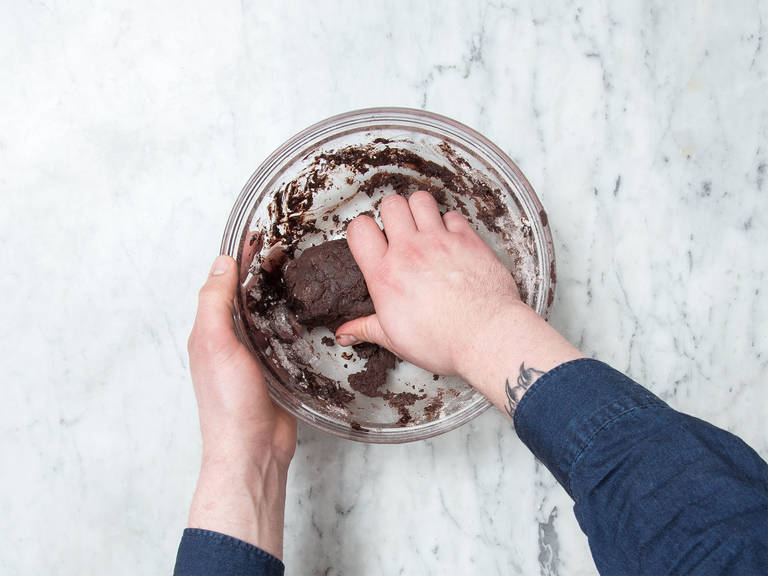 In a large bowl beat butter until creamy, approx. 1 min with the hand mixer with beaters. Gradually add in confectioner's sugar, cocoa, vanilla extract, and salt. Add flour and knead using your hands until dough is smooth.