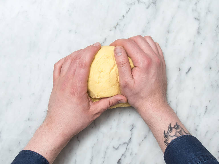 Add cornflour, most of the flour, two-thirds of the salt, olive oil, and water to a large bowl. Beat with a hand mixer with dough hook until a smooth dough forms. Knead the dough with your hands for approx. 5 min. more. Add more water if the dough crumbles too easily.