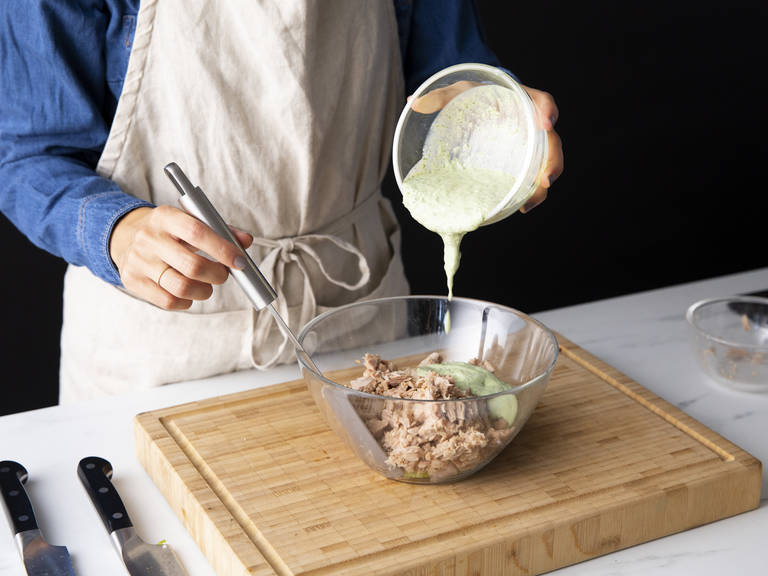 Thinly slice celery and add to a bowl. Thinly slice shallot and add to the bowl. Drain tuna and flake into the bowl. Add green goddess dressing, season with salt and pepper to taste, and mix to combine.
