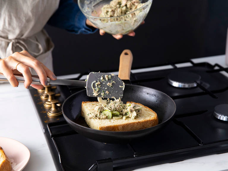 Heat a frying pan over medium high heat. Add butter. Place one slice of bread in the pan and let toast for approx. 2 min. Spoon over some of the tuna salad. Top with the other slice of bread, add more butter to the pan, and flip. Toast until golden brown. Remove from heat and enjoy immediately!