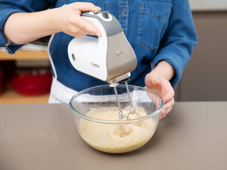 Preheat oven to 200°C/400°F. Beat eggs and brown sugar in a bowl until light and creamy. Add baking soda, flour, milk, rolled oats, coconut oil, and salt and beat to combine.